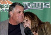 New Tampa Bay skipper Lou Piniella hugs his wife Anita before being introduced to the media Monday in St. Petersburg, Fla. Piniella asked to be released from his contract with the Seattle Mariners to work closer to home.