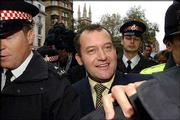 A Former butler to Princess Diana, Paul Burrell makes his way through the crowd after being released from the Old Bailey court in London, after the case against him collapsed and he was found innocent on all counts of theft. The trial came to a premature end after it emerged Friday that Burrell had told Queen Elizabeth II that he had been keeping items belonging to Diana for safekeeping.