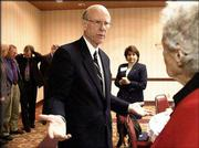 U.S. Sen. Pat Roberts, center, talks with Emily Taylor, Lawrence, after a speech at the Lawrence Holidome. At Friday's visit, sponsored by the Lawrence Chamber of Commerce, Roberts announced that Kansas University would receive $3.5 million in grants for research related to bioterrorism.