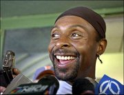 Oakland receiver Jerry Rice smiles during a news conference Thursday at the Raiders' practice facility in Alameda, Calif. Rice will be playing his former team, the San Francisco 49ers, on Sunday in Oakland.