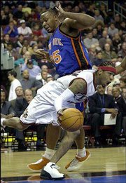 Philadelphia's Allen Iverson drives past New York's Clarence Weatherspoon. Iverson scored 35 points in the 76ers' 98-86 victory Friday in Philadelphia.