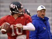 Kansas offensive coordinator and quarterbacks coach Nick Quartaro watches senior Jonas Weatherbie pass during practice. Weatherbie is expected to start today against Kansas State because of an injury to Bill Whittemore.