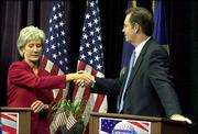 Kansas Democratic gubernatorial candidate Kathleen Sebelius, left, shakes hands with Republican candidate Tim Shallenburger after their Oct. 22 debate in Topeka. One of them will become governor-elect Tuesday night.