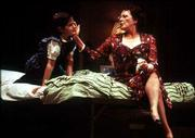 "Actress Linda Lavin, right, caresses the face of Sara Niemietz in a scene from the new play ""Hollywood Arms."" The play was written by comedian Carol Burnett and her daughter, Carrie Hamilton."
