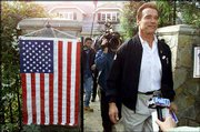 Actor Arnold Schwarzenegger leaves a polling station after voting in the Pacific Palisades section of Los Angeles. Voters passed an education proposition championed by Schwarzenegger, which would allocate as much as $550 million in existing school money to before- and after-school programs.