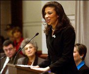 Miss America 2003 Erika Harold speaks at a meeting of the Connecticut Commission on Children in Hartford, Conn. Harold used the meeting to explain her youth violence platform. Harold will also promote abstinence during her yearlong reign.