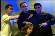 Members of The Hypothetical Seven, a Lawrence-based improv group, goof around at a recent practice. They are, top row left to right, Frank DelRosario, Matt Reiss and James Hilburn. Bottom center is Dan Spurgin.