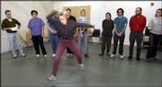 Linda Gaumnitz, center, unleashes her interpretation of a bad gym teacher at the Lawrence Arts Center, 940 N.H. Gaumnitz and fellow improvisers practiced last week at the center.