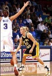 Lawrence native Katie Rhodes (23), a Free State High graduate and sophomore guard for Fort Hays State, looks to pass against Kansas sophomore Blair Waltz. The Jayhawks won, 73-56, Sunday at Allen Fieldhouse.