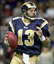St. Louis quarterback Kurt Warner prepares to throw. Warner played in Monday's 21-16 home victory over Chicago his first appearance since Sept. 29, when he broke the little finger of his right hand.