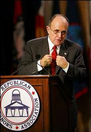 Former New York City Mayor Rudolph Giuliani speaks about domestic security measures with Republican governors and governors-elect at the Republican Governors Assn. Annual Conference.