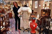 Sharon Dowdle, event manager at Butterfields auction house in San Francisco, displays a gown and personal effects owned by Esther Lederer, better known as Ann Landers. Property from the late advice columnist fetched nearly $250,000 Monday.
