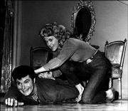 "Baer does a bit of &squot;rasslin&squot; with Donna Douglas, who played his cousin Elly May, in this 1963 file photo from ""The Beverly Hillbillies."" Others in the cast included Buddy Ebsen as Jed Clampett and Irene Ryan as Granny."