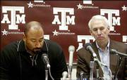 Texas A&M coach R.C. Slocum, right, and defensive line coach Buddy Wyatt discuss the death of 18-year-old Brandon Fails on Monday in College Station, Texas.