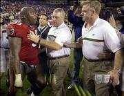 Green Bay security guard Mike Cygan separates Tampa Bay's Warren Sapp and Packers head coach Mike Sherman after Sunday's game in Tampa, Fla.