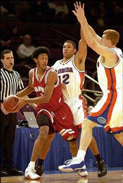 Stanford's Josh Childress looks for some help against Florida's Justin Hamilton, left, and Matt Bonner in the first half during the NIT at Madison Square Garden. The Cardinal beat the favored Gators, 67-65, on Wednesday.
