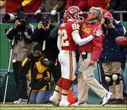 Kansas City's Dante Hall (82) receives a hug from coach Dick Vermeil after scoring on an 82-yard punt return against St. Louis. Hall became the first player in team history to run back a punt and a kickoff for touchdowns in the same game. The Chiefs blitzed the Rams, 49-10, Sunday in Kansas City, Mo.