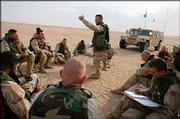 U.S. Army 1st Lt. Keith Zieber explains strategy to his mortar platoon before military excercises in the Kuwaiti desert. The military is conducting maneuvers there in preparation for possible conflict with Iraq.