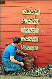 A decorative wall hanging at the Leach home in Leavenworth County bears Randy's name.