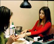 Jessica Schwartz, 17, of Deerfield, Ill., gets a manicure from