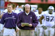 Kansas State coach Bill Snyder, center, walks the sideline. Snyder's team will play in the Holiday Bowl for the third time since 1995 when they take on Arizona State on Dec. 27 at San Diego.