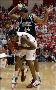 Indiana's Bracey Wright, front, is fouled by Vanderbilt's Corey Smith during Monday's game in Bloomington, Ind.