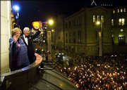 Nobel Peace Prize winner President Jimmy Carter and his wife, Rosalyn, greet a torchlight procession from the balcony of the Grand Hotel in Oslo, Norway. The Carters met the crowd Tuesday night before the Norwegian Nobel Committee's banquet.