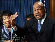 Newly elected chairman of the Congressional Black Caucus Rep. Elijah Cummings, D-Md., talks to reporters on Capitol Hill. At left is Rep. Eddie Bernice Johnson, D-Tex., the outgoing chairwoman. Members of the House Congressional Black Caucus on Tuesday said Senate Republican leader Trent Lott's apology for implying the country would have been better off had Strom Thurmond won the presidency when he ran in 1948 on a segregationist ticket was insufficient.