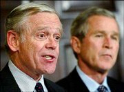 William Donaldson, left, an investment banker, speaks to reporters after being named chairman of the Securities and Exchange Commission. President Bush, right, made the announcement Tuesday in the Roosevelt Room of the White House. Donaldson is replacing Harvey Pitt, who resigned under pressure amid a spate of corporate scandals.