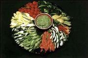 Taj Mahal Dip, which gets its green color from spinach, is shown served with assorted cutup vegetables.