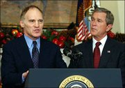 Wall Street investment banker Stephen Friedman, left, is President Bush's new top economic adviser. Bush introduced Friedman to the media Thursday in the Roosevelt Room of the White House.