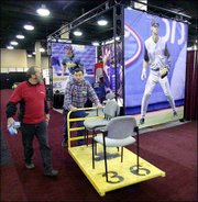 Workers set up displays at a hotel in Nashville, Tenn. The winter meetings, which run through Monday, began Friday.