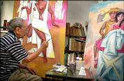 Cuban painter Adigio Benitez works in his studio in Havana. Benitez is among dozens of Cuban artists flourishing in an era of change thrusting contemporary Cuban sculpture and painting into the world.