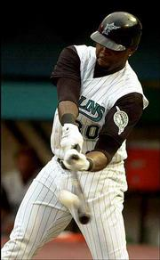 Outfielder Cliff Floyd, seen here batting for the Florida Marlins on June 1, 2002, signed a multiyear deal with the New York Mets on Friday.
