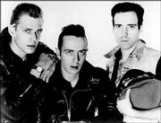 Members of the British rock band the Clash, from left, Paul Simonon, Joe Strummer and Mick Jones are shown in this handout photo released by Epic Records in 1983. Strummer, who was the band's guitarist, vocalist and songwriter alongside Mick Jones, died on Sunday.