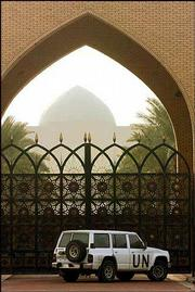 A U.N. vehicle stands at the entrance after United Nations weapons inspectors entered the Al-Sajoud palace, one of Saddam Hussein's presidential palaces in Baghdad in this Dec. 3 photo.