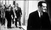 "Convicted killers Perry Smith, left in suit, and Richard Hickock, right, walked down the hall of the old Federal Building in Topeka in 1963 on their way to an unsuccessful appearance in U.S. District Court to overturn their 1960 conviction. They were sentenced to death for the 1959 murders of four members of the Herbert Clutter family in Holcomb. An appeal to the Kansas Supreme Court was also denied. The subjects of Truman Capote&squot;s ""In Cold Blood,"" they were hanged April 14, 1965, at the Kansas State Penitentiary in Lansing."