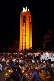 Nearly 3,000 people, including Kansas University students, wanting to commemorate the anniversary of Sept. 11 gathered at the Campanile Wednesday night to pay their respects to those who died last year in the terrorist attacks.