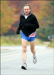 Bernd Heinrich, 62, runs in the Maine Track Club's 50-mile race in Brunswick. Heinrich, a University of Vermont biology professor, has used his running experiences to develop and refine his theories about evolution.