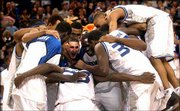 Memphis players celebrate after their game against Illinois. The Tigers knocked off the seventh-ranked Fighting Illini, 77-74, Saturday at the Pyramid in Memphis, Tenn.