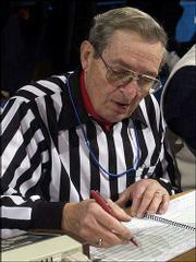 Doug Beene, the official scorekeeper for Kansas University basketball games, has been working the sidelines of KU games since 1963 and has been the scorekeeper since 1973. Beene has had to adapt to the fast pace of modern basketball, which eventually forced him to hire an assistant.