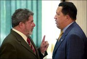 Brazil's new president, Luiz Inacio Lula da Silva, left, talks with his Venezuelan counterpart, Hugo Chavez, during a meeting at the presidential palace in Brasilia. The two met Thursday, a day after Silva was inaugurated as Brazil's first elected leftist leader.