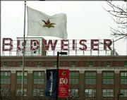 While other companies big and small have struggled in recent years, Anheuser-Busch has simply chugged along, pushing to 16 its string of quarters with double-digit earnings-per-share growth. The Anheuser-Busch flag is shown flying above the company's brew house at its St. Louis headquarters.