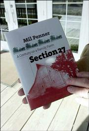 "Author Mil Penner holds his book, ""Section 27: A Century on a Family Farm"" at his home near Inman, where he was raised. The book traces the history of the one-square-mile piece of land that Penner&squot;s family settled in 1874."