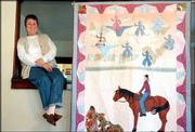 "Terry Clothier Thompson, owner of Peace Creek Patterns & Quilts, will be one of the vendors at the Lawrence Cowboy Winter Gathering. On Friday, she displayed a quilt she titled ""Stoney Bowen and the Ghost Riders in the Sky"" at her home in East Lawrence."