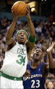 Boston's Paul Pierce (34) beats Washington's Michael Jordan (23) to the hoop during Monday's game in Boston.