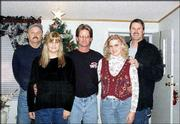 Reunited at last. Richard Ray, Lawrence, meets with his sister, Debbie Douglass, and half-siblings for the first time. Adoption tore them apart, but after searching for his family for a year and a half, Ray gathered all the siblings Dec. 7 in Lawrence. Back row, from left, are Ray; Doug Ochs, Rogers, Ark.; and Dennis Phelps, Wichita. Front row, from left, are Debbie Douglass, Elbright, Colo., and Julie Castillo, Wichita. Ray submitted the picture.
