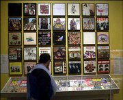 "A museum patron looks at a collection of Beatles album covers on display with an exhibit titled ""The Beatles: Now and Then,"" a collection of photographs by photojournalist Harry Benson, at the Albany Institute of History and Art in Albany, N.Y. Dutch police claim to have recovered hundreds of original Beatles tapes that were stolen in the 1970s."