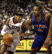 Philadelphia's Allen Iverson, left, drives against New York's Latrell Sprewell. The Knicks defeated the 76ers, 114-112, Friday night in Philadelphia.