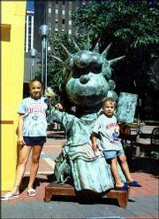 Kansas University fans Haley Holdredge, 11, and Adam Noreen, 4, hang out with Lucy from Peanuts, posing as the Statue of Liberty in St. Paul, Minn. Haley is the daughter of Jeff Holdredge and Karen Noreen. Adam is the son of Frank and Karen Noreen. All are of Minneapolis, Minn. Mary Rogers, Lawrence, submitted the picture.